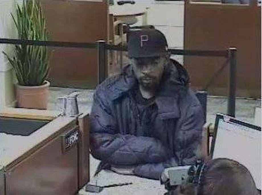Surveillance video of the suspect of two robberies at a Wells Fargo Bank located at 2220 Mountain Boulevard in Oakland.  He is described as a male black, 25-35 years old, approximately 5?-9? tall, weighing approximately 180 lbs. Photo: Oakland Police Dept.