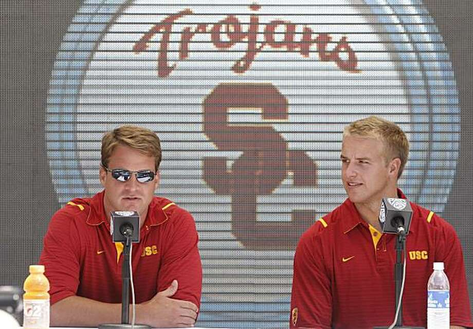 Southern California football coach Lane Kiffin, left, and quarterback  Matt Barkley speak to reporters during the Pac-10 Football Media Day at the Rose Bowl in Pasadena, Calif, on Thursday, July 29, 2010. Photo: Damian Dovarganes, AP
