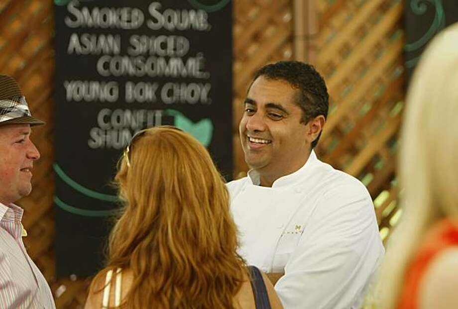 Top Chef Michael Mina greets guests during the lunch at the 30th annual Auction Napa Valley, Saturday June 5, 2010, in St. Helena, Calif.  The auction raised more than $8.5 million for local non-profits. Photo: Lacy Atkins, The Chronicle
