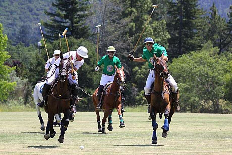 (LF) Erik Wright, (LR) Jared Sheldon of the Knights of St. John team, (C) Lowell Gibbs and (R) Tom Conant, Jr. of the Trione Vineyards team. Image from the Wounded Warriors Polo Benefit, held June 20 at the Trione Polo Field in Oakmont, California. Proceeds benefited the Pathway Home in Yountville and the National Center for Equine Facility Therapy in Woodside, bith of which treat severely wounded veterans of the wars in Iraq and Afghanistan. Photo: ChristineGeorge.com