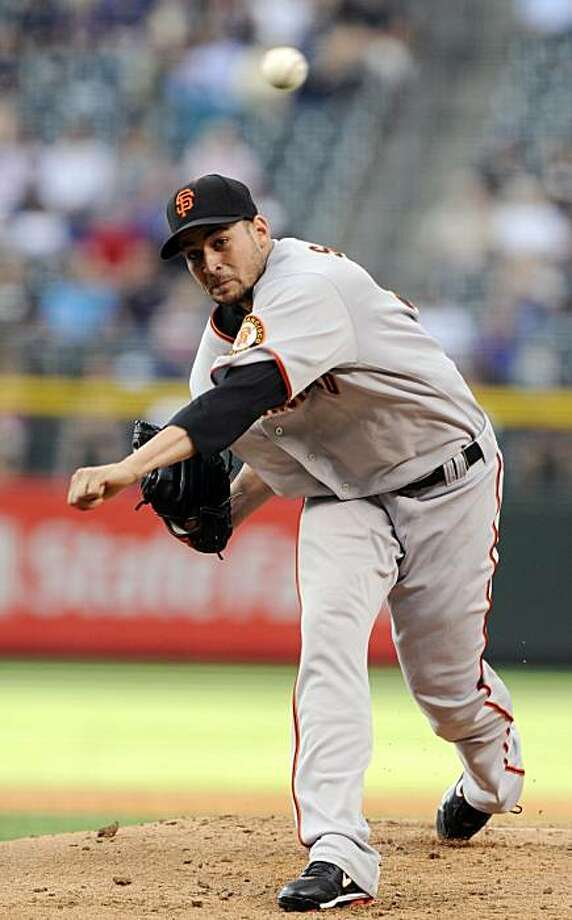 San Francisco Giants starting pitcher Jonathan Sanchez throws in the first inning of a baseball game against the Colorado Rockies at Coors Field in Denver on Tuesday, August 3, 2010. Photo: Chris Schneider, AP
