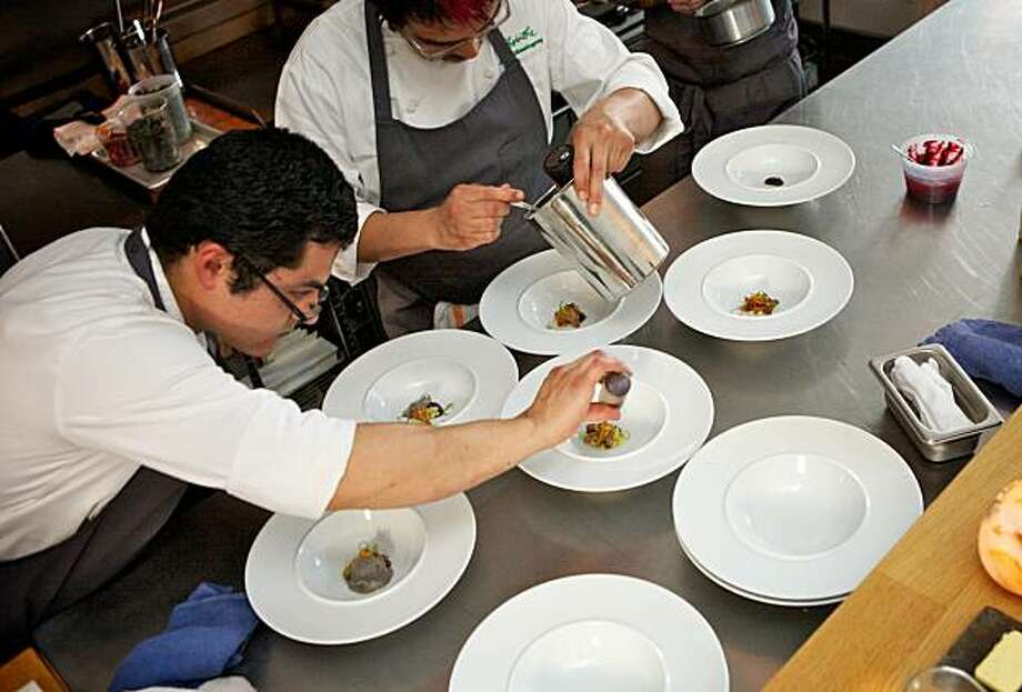 "Pastry chefs Luis Villavelazquez, Kyle Caporicci and Carlos Salgado prepare dishes for the special ""Save Room for Dinner"" tasting event at Commis Restaurant in Oakland on July 12, 2010. Photo: Thor Swift"
