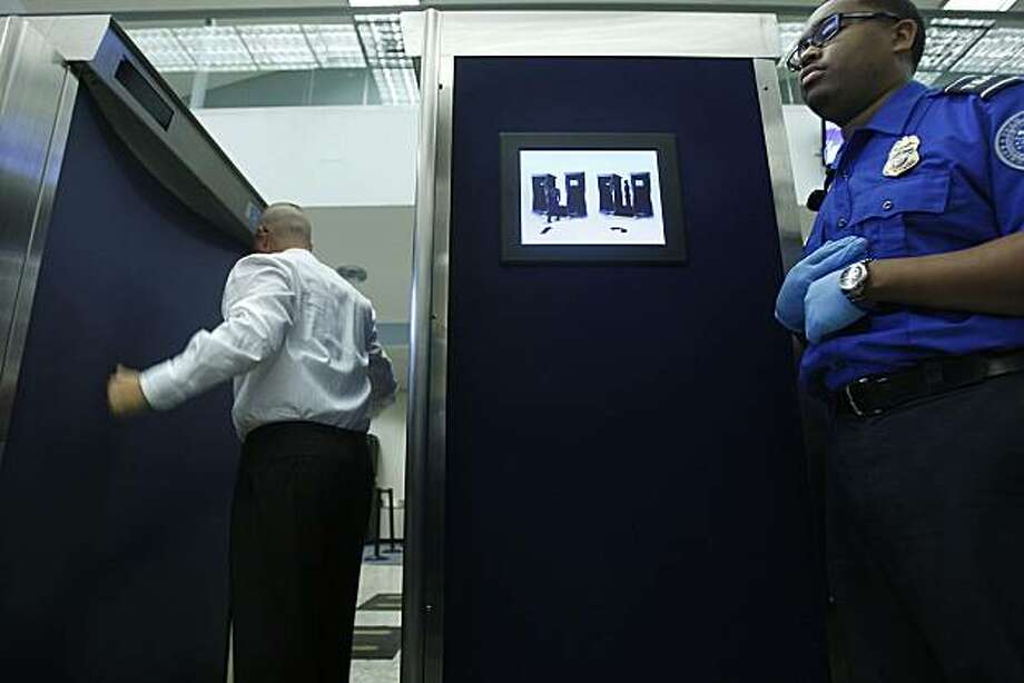 The TSA demonstrates new advanced security imaging at the security gate of Oakland International Airport on Tuesday. Photo: Liz Hafalia, The Chronicle