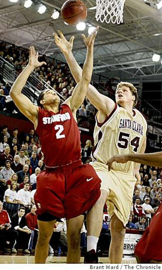 Stanford's Landry Fields(2) battles with John Bryant(54) of Santa Clara in the 77-69 Stanford Cardinal victory in Santa Clara, Calif., on Tuesday, December 23, 2008. Photo: Brant Ward, The Chronicle