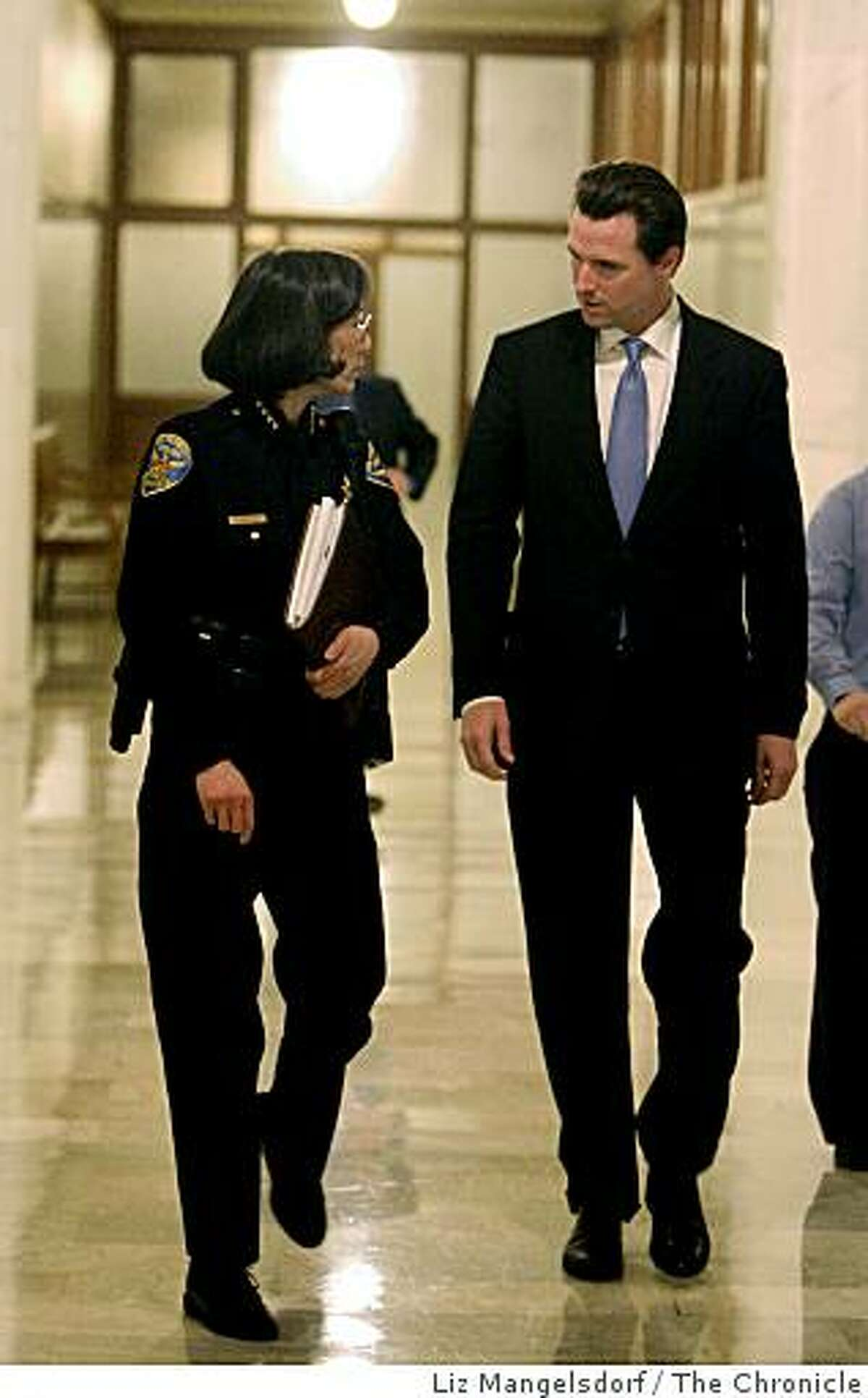 Mayor Gavin Newsom leaves the SF Stat meeting and walks to his office at San Francisco City Hall with Police Chief Heather Fong on Feb. 5, 2007. Earlier, Newsom releasing a press release saying he had stopped drinking. SF Stat is a monthly meeting on city statistics.