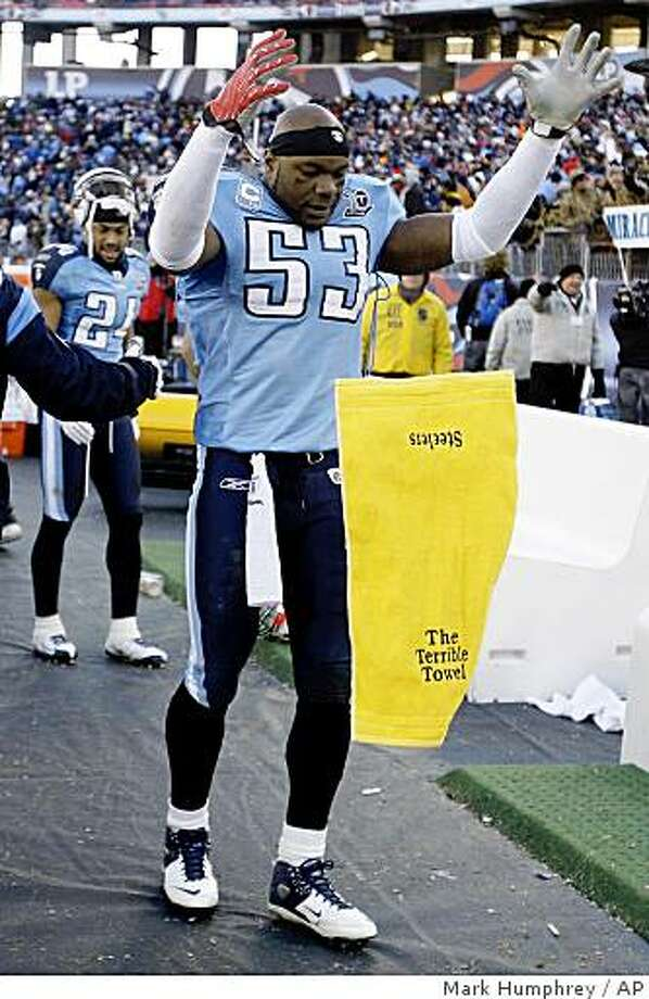 "Tennessee Titans linebacker Keith Bulluck drops a Pittsburgh Steelers ""Terrible Towel"" to the ground in the final moments of the Titans' 31-14 win over the Steelers in an NFL football game in Nashville, Tenn., Sunday, Dec. 21, 2008. (AP Photo/Mark Humphrey) Photo: Mark Humphrey, AP"