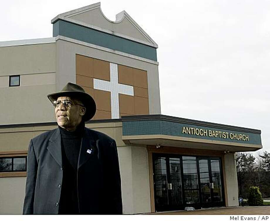 **APN ADVANCE FOR SUNDAY DEC.21** Rev. John O. Parker at his Antioch Baptist Church Tuesday, Dec. 9, 2008, in Camden, N.J. Hundreds of people wanted by authorities  surrendered at the church during a recent Fugitive Safe Surrender day. Fugitive Safe Surrender has been held in 11 U.S. cities, resulting in the resolution of 14,892 cases. (AP Photo/Mel Evans) Photo: Mel Evans, AP