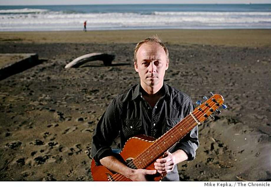 Chris Haugen stands with his Weissenborn guitar on Ocean Beach on Wednesday, Dec. 17, 2008 in San Francisco, Calif. Weissenborn recently released a new CD called Seahorse Rodeo. Photo: Mike Kepka,, The Chronicle