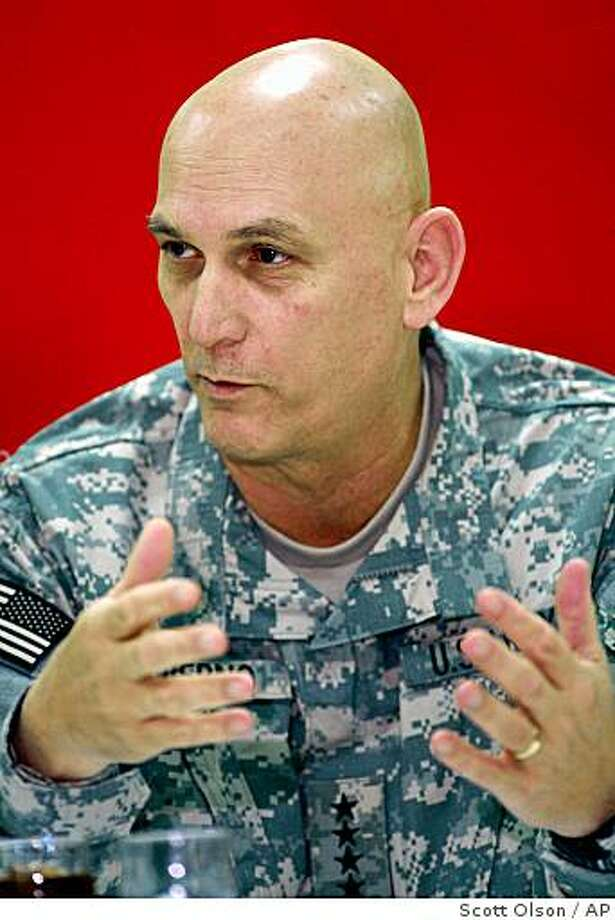 Gen. Ray Odierno, left, commander of multi-national forces Iraq, speaks to the media before meeting with U.S. Defense Secretary Robert Gates Saturday, Dec. 13, 2008, in Balad, Iraq.  (AP Photo/Scott Olson, Pool) Photo: Scott Olson, AP