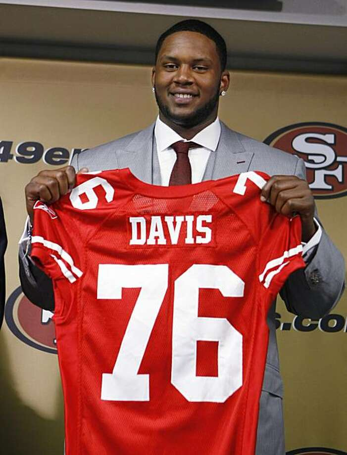 San Francisco 49ers first-round draft pick Anthony Davis, a tackle from Rutgers, holds up a jersey during an NFL football news conference at 49ers headquarters in Santa Clara, Calif., Friday, April 23, 2010. Photo: Paul Sakuma, AP