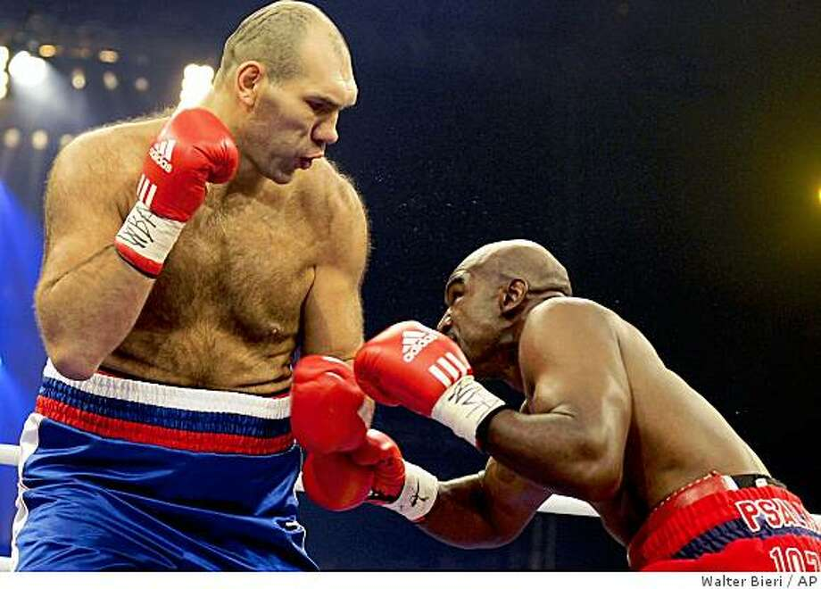 Russian WBA heavyweight champion Nikolai Valuev, left, and Evander Holyfield from the United States exchange punches during their WBA heavyweight boxing world championships fight at the Hallenstadion venue in Zurich, Switzerland, Saturday, Dec. 20, 2008. (AP Photo/Keystone, Walter Bieri) Photo: Walter Bieri, AP