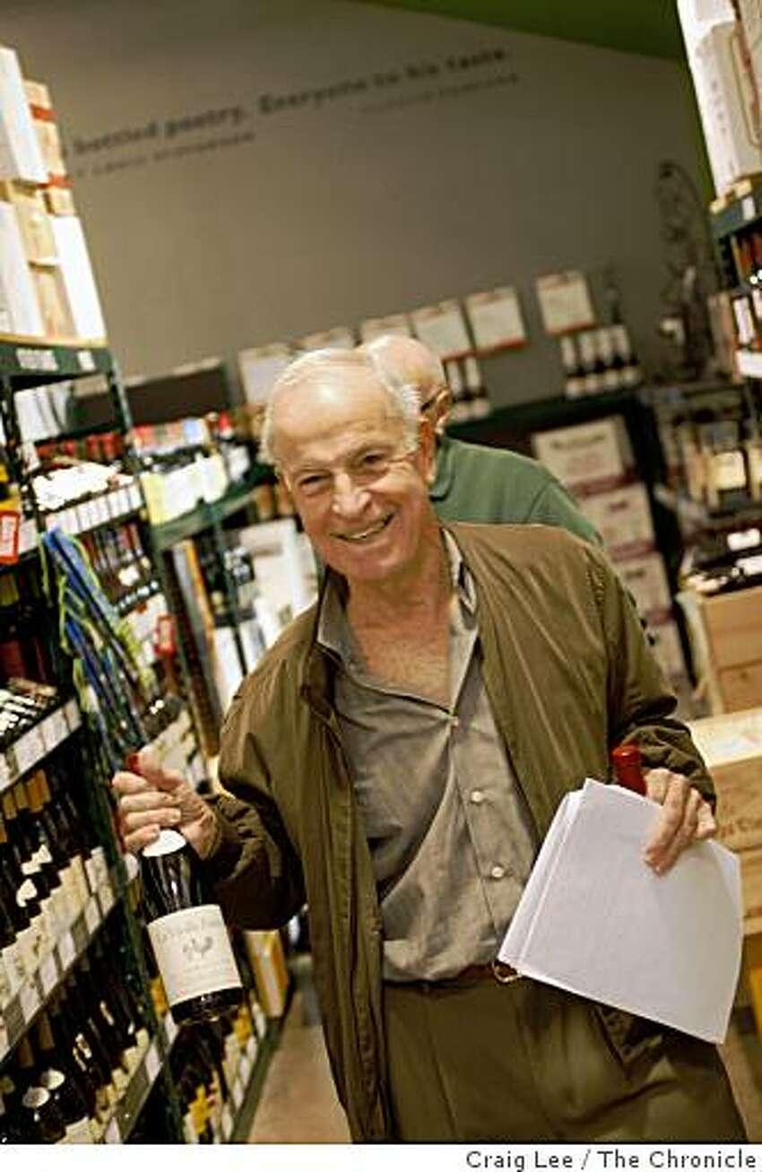 Robbie Cook shopping for bargain wines at BevMo in San Rafael, Calif., on December 12, 2008.