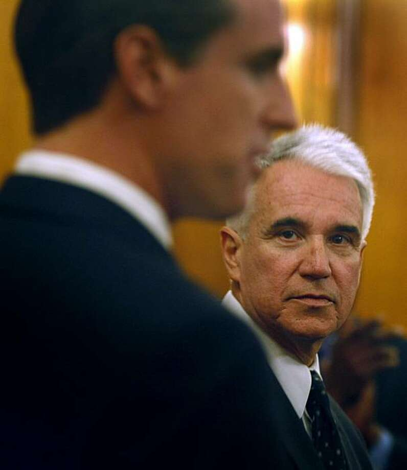 Police Chief George Gascon listens to Mayor Gavin Newsom speak to the news media after a private swearing-in ceremony in Newsom's office in San Francisco, Calif., on Friday, Aug. 7, 2009. Photo: Paul Chinn, The Chronicle
