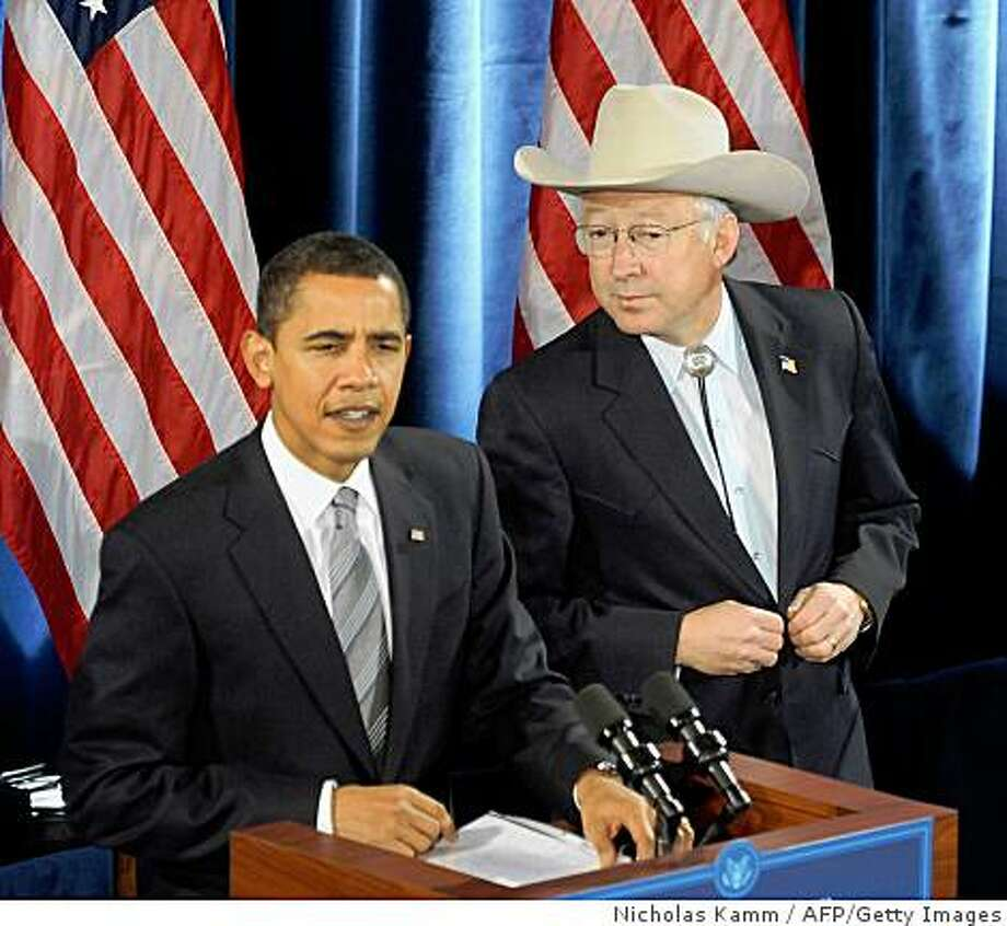 "US president-elect Barack Obama (L) introduces Colorado senator Ken Salazar  as interior secretary and Tom Vilsack (not seen) as agriculture secretary at a press conference in Chicago on December 17, 2008. ""Together they will serve as guardians of the American landscape on which the health of our economy and the wellbeing of our families so heavily depends,"" Obama said.      AFP PHOTO/Nicholas KAMM (Photo credit should read NICHOLAS KAMM/AFP/Getty Images) Photo: Nicholas Kamm, AFP/Getty Images"