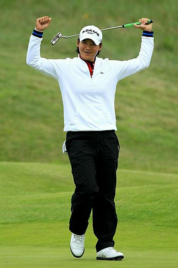 SOUTHPORT, ENGLAND - JULY 29:  Yani Tseng of Taiwan celebrates holing an eagle putt on the 18th green during the first round of the 2010 Ricoh Women's British Open at Royal Birkdale on July 29, 2010 in Southport, England. Photo: David Cannon, Getty Images