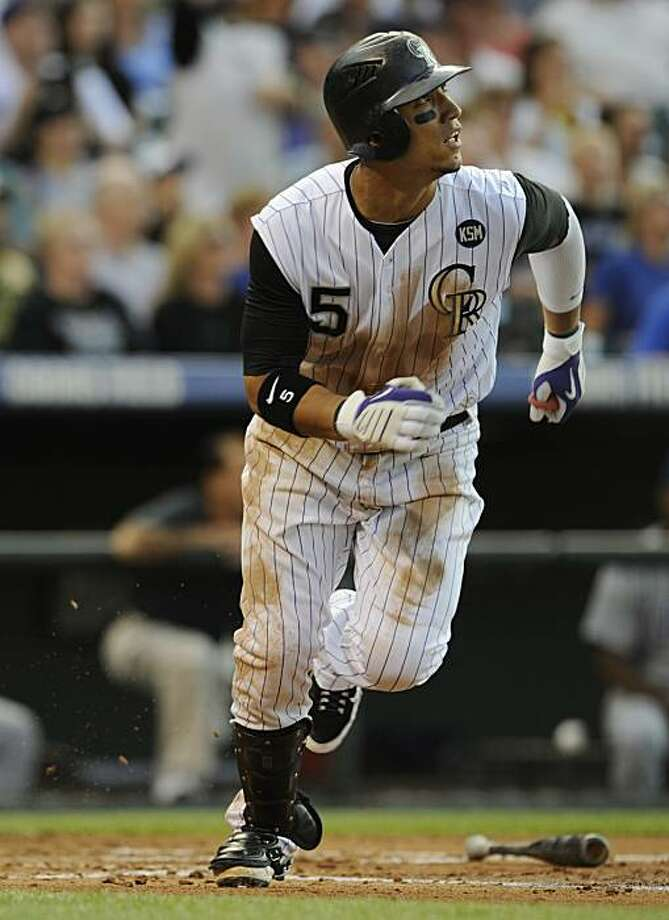 Colorado Rockies' Carlos Gonzalez connects on a triple against the Chicago Cubs in the third inning of a baseball game at Coors Field in Denver, Colo. on Saturday, July 31, 2010. Photo: Matt McClain, AP