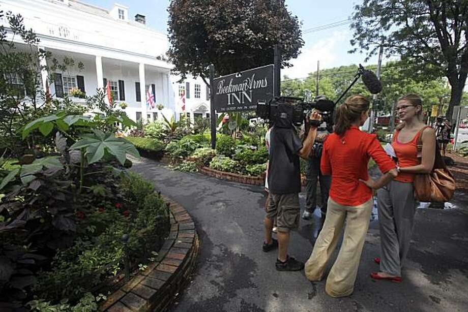 Elisabeth Gruender, right, a producer with ARD German TV, is interviewed by Today show host Natalie Morales, second from right, in front of the Beekman Arms Inn, Wednesday, July 28, 2010, in Rhinebeck, N.Y.  Chelsea Clinton and her parents have not yet confirmed that the former first daughter's wedding  is being held in Rhinebeck Saturday. Still, signs congratulating her hang in shop windows, residents are talking to TV crews and officials are bracing for crowds. Photo: Mary Altaffer, AP