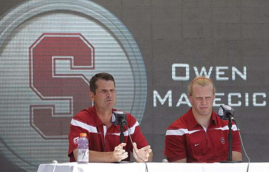 Stanford football coach Jim Harbaugh, left, and Owen Marecic speak to reporters during the Pac-10 Football Media Day at the Rose Bowl in Pasadena, Calif, on Thursday, July 29, 2010. Photo: Damian Dovarganes, AP