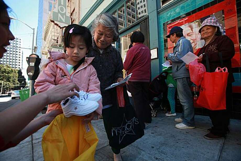 "Annie Xu, 6 years old,  picked up new shoes at the Chinatown Community Development Center with her grandma in San Francisco, Calif., on Wednesday, July 28, 2010.  The organizer ""My New Red Shoes"" helps homeless and low-income families with a positive back-to-school experience of having new shoes. Photo: Liz Hafalia, The Chronicle"