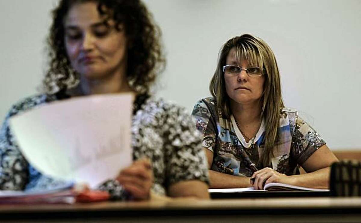 Miriam Munoz and Debbie Hays, both from Livermore, listen as Ron Russo, the manager of