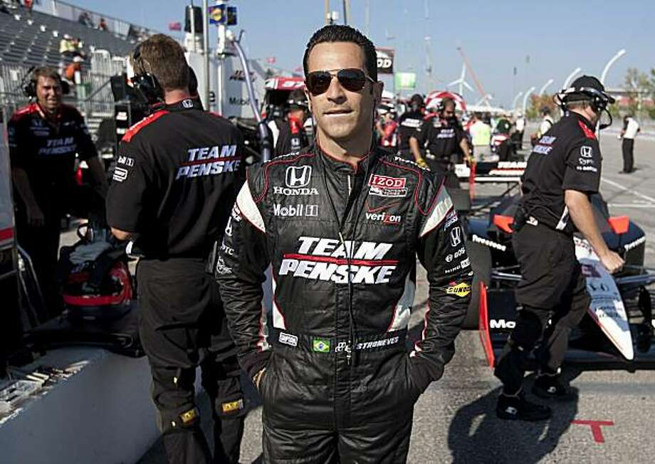 Driver Helio Castroneves of Brazil prior to his practice session for the Toronto INDY in Toronto on Saturday, July 17, 2010. Photo: Darren Calabrese, AP