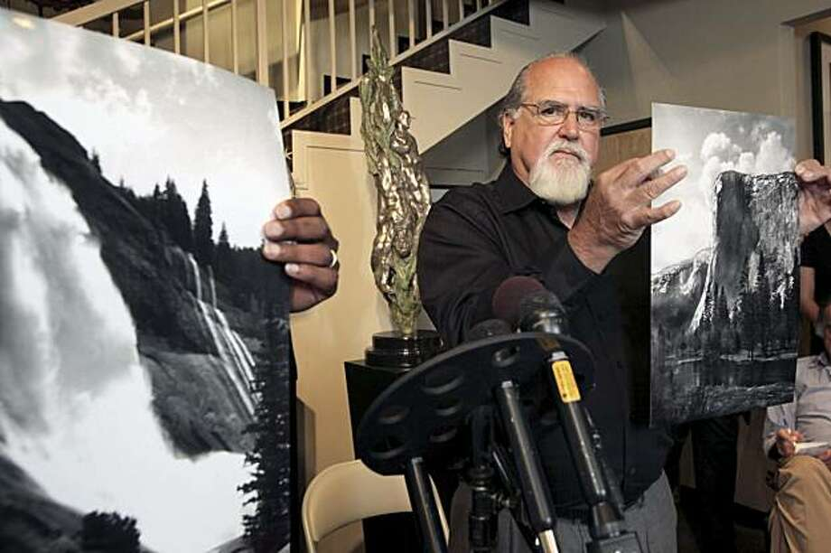 Rick Norsigian holds up a photograph made from a glass negative shot by the late photographer Ansel Adams during a news conference in Beverly Hills, on Tuesday July 27,2010. A lawyer says the trove of old glass negatives found in a garage sale for 45 dollars by Norsigian a painter from Fresno, Calif.  has been authenticated as the work of  photographer Ansel Adams and are worth at least $200 million. Photo: Nick Ut, AP