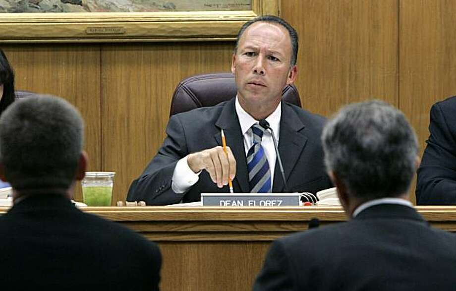State Sen. Dean Florez, D-Shafter, center,  chair of the Government Organization committee, questions Dr. Kevin Reilly, deputy director of the California Department of Health Services, left, about his agency's response to the recent E. coli outbreak in spinach, during a hearing held at the Capitol in Sacramento, Wednesday, Oct. 11,2006. Florez said state and federal food and health agencies had ample warning but didn't do enough to prevent the E. coli outbreaks like the ones that killed three, sickened hundreds, and shut down California's spinach and lettuce production in recent weeks.(AP Photo/Rich Pedroncelli) Ran on: 10-12-2006 State Sen. Dean Florez (center) questions Dr. Kevin Reilly of the Health Services Department (left). Photo: Rich Pedroncelli, AP