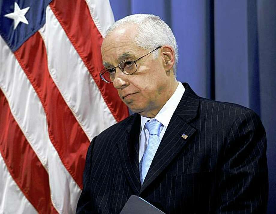 Attorney General Michael Mukasey listens during a news conference in Washington in June 2008. . At the Justice Department, a spokesman said that Mukasey had recused himself from the investigation into Bernard Madoff. Photo: Susan Walsh, AP