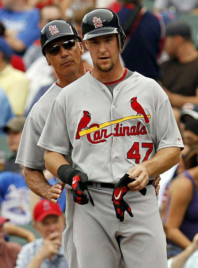St. Louis Cardinals first base coach Dave McKay, left, talks to Ryan Ludwick during the second inning of a baseball game against the Chicago Cubs Saturday, July 24, 2010, in Chicago. Photo: Nam Y. Huh, AP