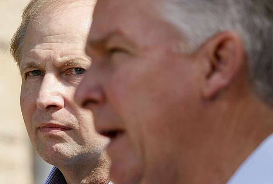 BP PLC CEO of Gulf Coast Restoration Organization Bob Dudley, left, listens as James Lee Witt speaks at a news conference held to announce Witt's hiring as an advisor to BP's Deepwater Horizon oil spill response in Biloxi, Miss., Friday, July 30, 2010. Witt, the former FEMA director under President Bill Clinton, is expected to advise BP through its long-term response and recovery efforts. Photo: Patrick Semansky, AP
