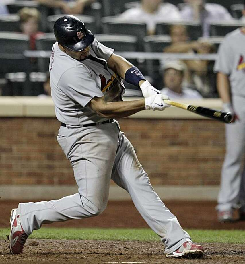 St. Louis Cardinals' Albert Pujols hits a 13th-inning RBI single in a baseball game against the New York Mets in New York, Wednesday, July 28, 2010. Photo: Kathy Willens, AP