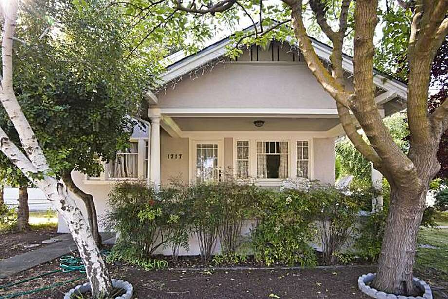 Located in Redwood City, the property at 1717 Jefferson Avenue sits on a 6,330-square-foot lot and includes three bedrooms and two bathrooms. It was built in 1925 and covers 1,716 square feet. It's on the market for $749,000. Photo: Dennis Mayer, Obeo