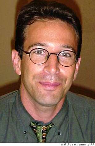 FILE ** Wall Street Journal reporter Daniel Pearl is shown in this undated file photo. American authorities investigating the killing of Pearl in Pakistan now believe that he was slain by Khalid Shaikh Mohammed, the alleged mastermind of the Sept. 11 attacks. (AP Photo/Wall Street Journal) ALSO RAN: 1/1/2004 Daniel Pearl, left, was slain by Khalid Shaikh Mohammed, right, U.S. officials say. ALSO RAN 03/16/07 Photo: Wall Street Journal, AP
