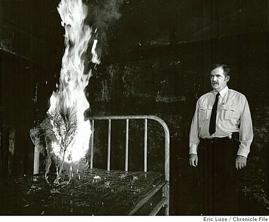 Wayback21.jpg Dec. 20, 1983Lt. Gary Meltzer, fire prevention, watches as a sample piece of a Christmas tree at the Cathedral Hill hotel goes up in flames.  Eric Luse/Chronicle File Photo: Eric Luse, Chronicle File