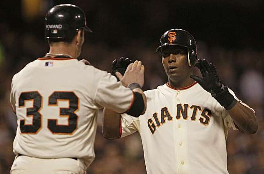 San Francisco Giants' Edgar Renteria, right, is congratulated by teammate Aaron Rowand (33) after Renteria hit a two run home run off Florida Marlins' Brian Sanches during the eighth inning of a baseball game Tuesday, July 27, 2010, in San Francisco. Photo: Ben Margot, AP