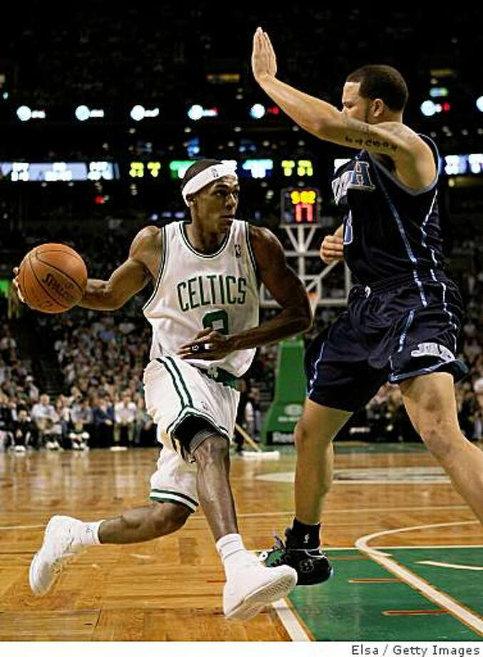 BOSTON - DECEMBER 15: Rajon Rondo #9 of the Boston Celtics heads for the net as Deron Williams #8 of the Utah Jazz defends on December 15, 2008 at TD Banknorth Garden in Boston, Massachusetts. The Celtics defeated the Jazz 100-91. NOTE TO USER: User expressly acknowledges and agrees that, by downloading and or using this Photograph, user is consenting to the terms and conditions of the Getty Images License Agreement.  (Photo by Elsa/Getty Images) Photo: Elsa, Getty Images