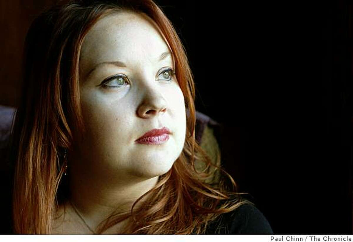 Jessica Palmer is seen at her home in Emeryville, Calif., on Wednesday, Dec. 17, 2008. Palmer, who needs medication to control an allergy condition, faces expensive health insurance costs after getting laid off from her job in late October.