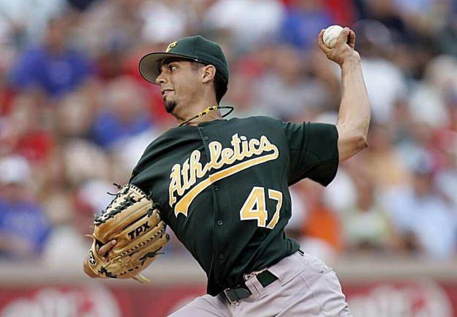 Oakland Athletics pitcher Gio Gonzalez throws during the first inning of  a baseball game against the Texas Rangers in Arlington, Texas, Tuesday, July 27, 2010. Photo: Mike Fuentes, AP