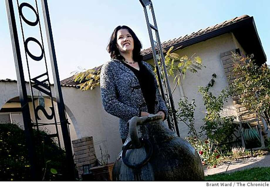 Caroline Hegarty of Vallejo has done 15 rent-option deals, but plans to make many more. She is photographed on Regents Park Drive in Vallejo Tuesday, December 9, 2008 in front of her first rent-option transaction. Photo: Brant Ward, The Chronicle