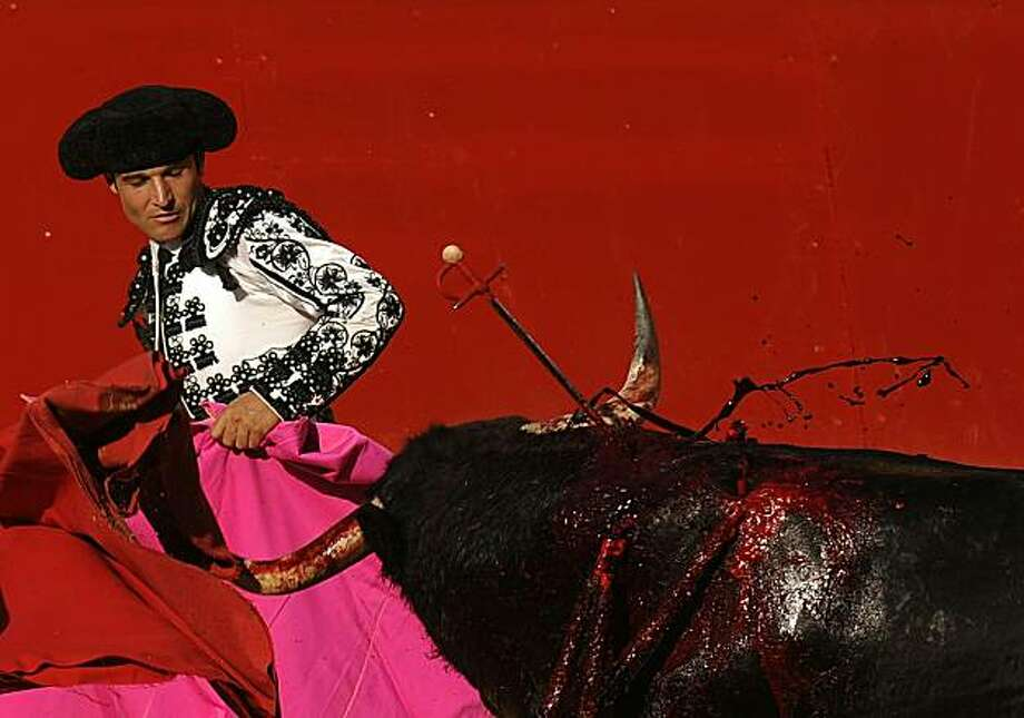 This file picture dated July 10, 2010 shows blood gushing from a bull during a bullfight at the San Fermin festival. Bullfighting in Spain could suffer its biggest setback to date on July 27, 2010, when the Catalonia parliament votes whether to ban the practice in the separatist-minded northeastern region. Photo: Pedro Armestre, AFP/Getty Images