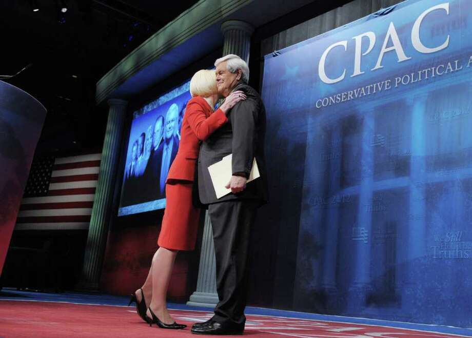 Republican presidential candidate and former House Speaker Newt Gingrich receives a hug from his wife Callista after she introduced him speaks at the 39th Conservative Political Action Committee February 10, 2012 at a hotel in Washington, DC. Photo: MANDEL NGAN, AFP/Getty Images / AFP