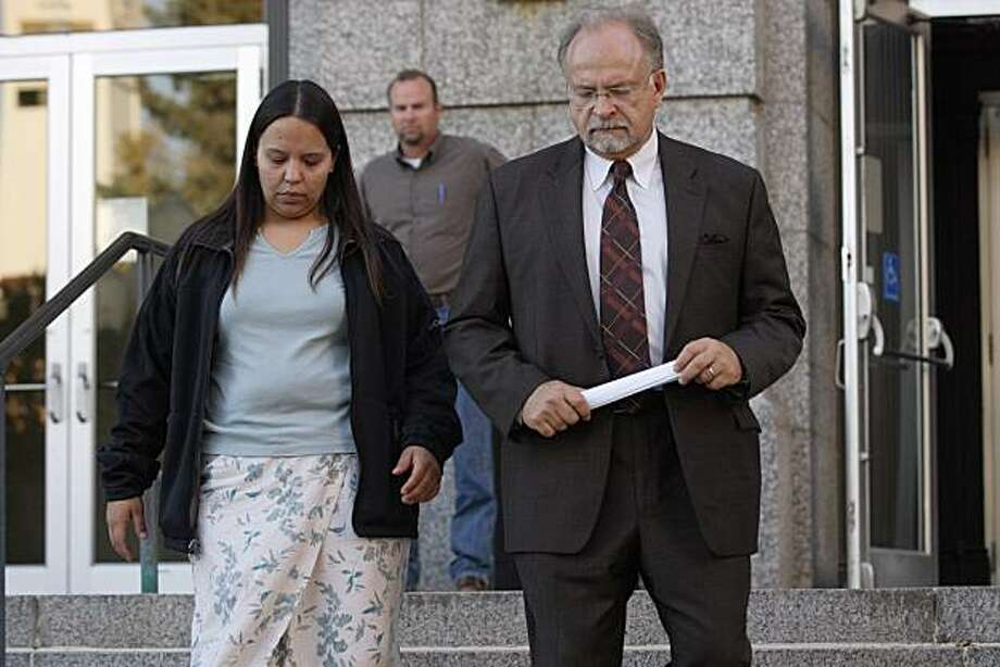 Jammie Thomas of Brainerd, Minn., left, leaves the federal courthouse with her attorney, Brian Toder of Minneapolis after the jury returned a verdict against her on the third and final day of her civil trial for alleged music pirating through illegal sharing of song files in Duluth, Minn., Thursday, Oct. 4, 2007. She was the defendant in a Recording Industry Association of America lawsuit. Thomas and Toder left without speaking to the press. Photo by Julia Cheng for Associated Press Photo: Julia Cheng, AP