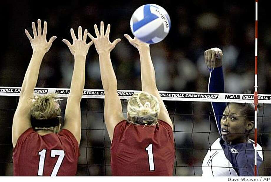 Penn State's Megan Hodge (11) gets a kill past Nebraska's Amanda Gates (17) and Sydney Anderson (1) in the first set of a semifinal of the NCAA women's volleyball tournament Thursday, Dec. 18, 2008, in Omaha, Neb. (AP Photo/Dave Weaver) Photo: Dave Weaver, AP