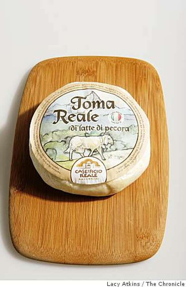 Toma Reale cheese for the Cheese Course Column, photographed in studio, Thursday Dec. 11, 2008  in San Francisco, Calif. Photo: Lacy Atkins, The Chronicle