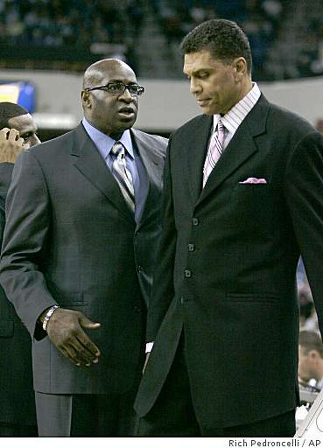 Sacramento Kings assistant coach Kenny Natt, left, talks with Kings head coach Reggie Theus during the Kings 97-95 overtime loss to the Phoenix Suns in an NBA basketball game in Sacramento, Calif., Friday, Nov. 14, 2008. The Kings fired Theus Monday Dec. 15, 2008. Assistant coach Kenny Natt will take over the Kings, spokesman Troy Hanson said. (AP Photo/Rich Pedroncelli) Photo: Rich Pedroncelli, AP