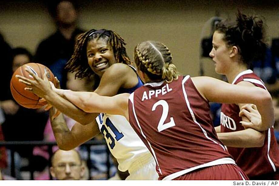 Duke's Keturah Jackson (31) is pressured by Stanford's Jayne Appel (2) and Jillian Harmon, right, during the second half of an NCAA college basketball game in Durham, N.C., Tuesday, Dec. 16, 2008. Duke beat Stanford 56-52. (AP Photo/Sara D. Davis) Photo: Sara D. Davis, AP