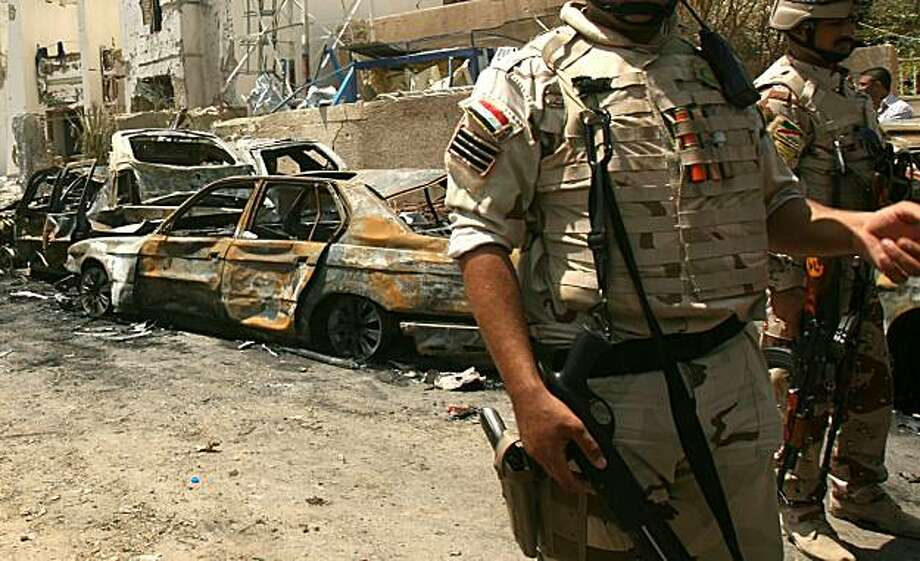 Iraqi soldiers seal off the street following a suicide car bomb that targeted the Al-Arabiya TV channel's office in central Baghdad on July 26, 2010, detonated killing several people, the interior ministry said. Photo: Ali Al-saadi, AFP/Getty Images