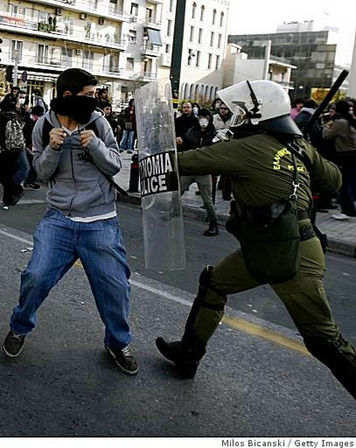 ATHENS, GREECE - DECEMBER 15:  A Riot policeman clashes with a demonstrator during student protests on December 15, 2008 in Athens, Greece. Protests and riots have continued for several days in Greece after the fatal shooting of 15-year-old schoolboy Alexis Grigoropoulos by police on December 6, 2008.  (Photo by Milos Bicanski/Getty images) Photo: Milos Bicanski, Getty Images