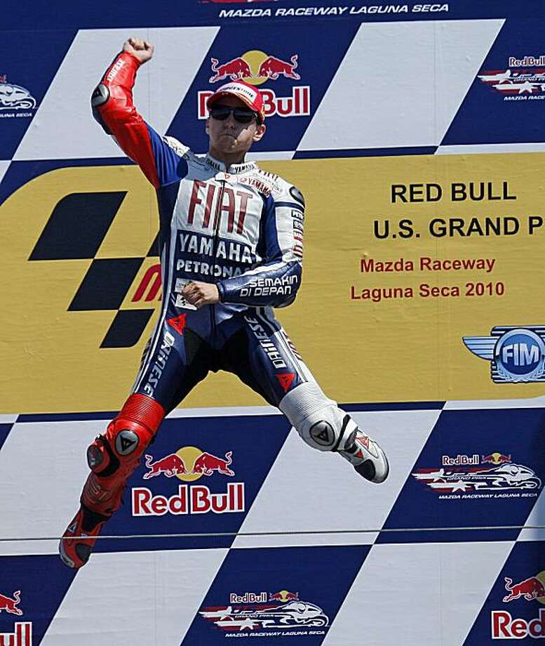Jorge Lorenzo of Spain celebrates after winning the Red Bull U.S. Grand Prix MotoGP world championship motorcycle race Sunday, July 25, 2010, at Laguna Seca raceway in Monterey, Calif. Photo: Ben Margot, AP