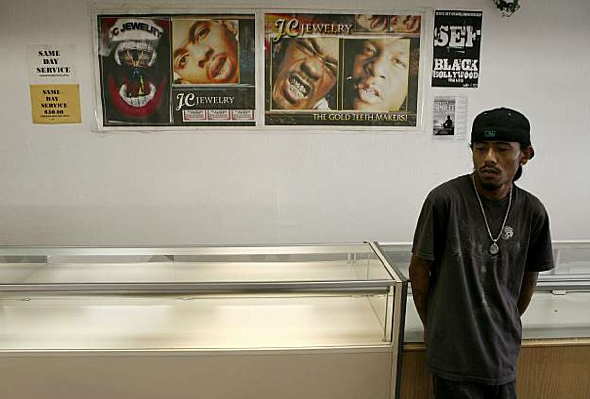Co-owner of JC Jewelry, Tony Moeuth stands in front of empty display cases that held a majority of his stock before looted during the riots following he Mehserle conviction on Friday, July 23, 2010 in Oakland, Calif.